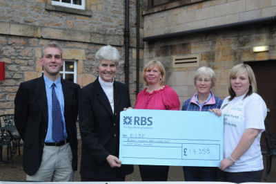 Samantha Morrison (right) presents a cheque to Philippa Gammell (second left), chair of the Equine Grass Sickness Fund. Also pictured (from left) are Prof. Bruce McGorum, Christine Morrison and Heather Younie of Cranloch Riding Centre. (Photos courtesy of The Northern Scot)